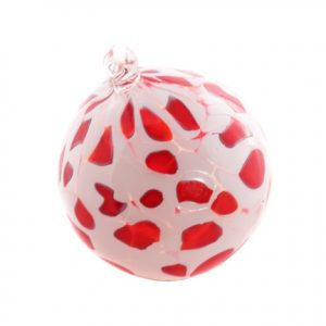 Bold spots of translucent red on a field of white make this ornament stand out.